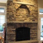 Cultured Stone Fireplace With Sandstone Hearth And Mantel
