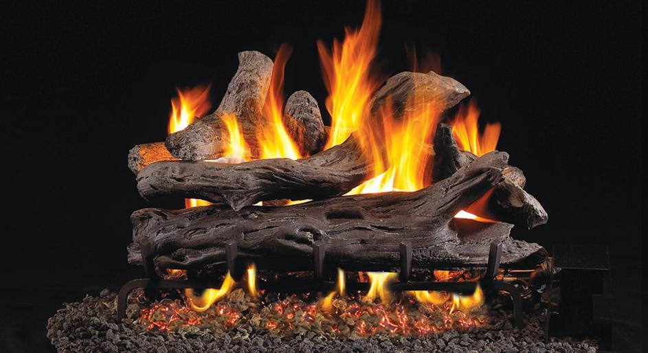 Vented gas fireplace logs