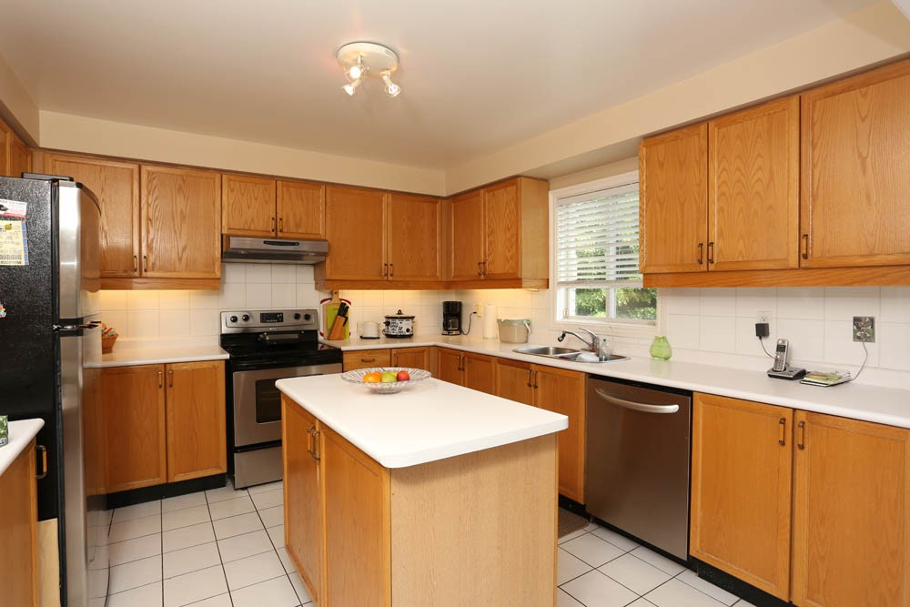 10 kitchen cabinets refacing ideas a creative mom for Refacing kitchen cabinets materials