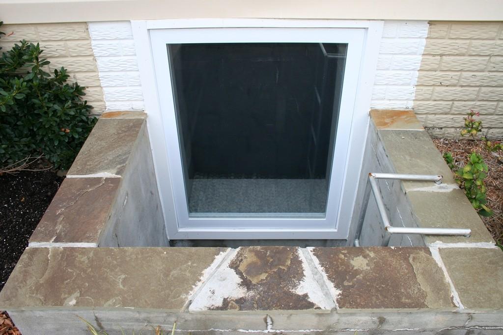 Basement egress window wells