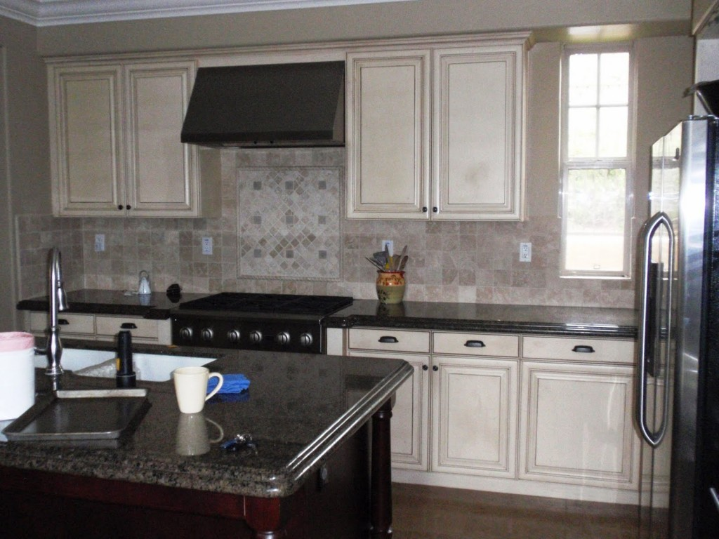 What is Involved with Refinishing Kitchen Cabinets?