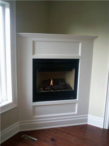 Built in concrete fireplace design with white mantel