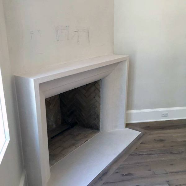 Concrete mantel wood burning corner fireplace design