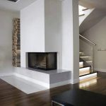 Corner Fireplace Design With Built In Firewood Storage Area