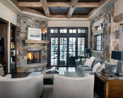 Rustic stone with wood beams corner fireplace design