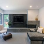 smooth-concrete-corner-fireplace-design