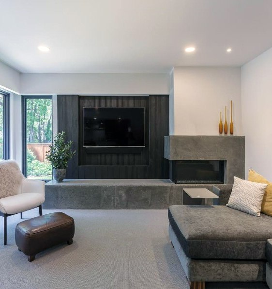 Smooth concrete corner fireplace design