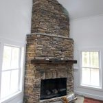 Stone Corner Fireplace Design With Wood Mantel Beam